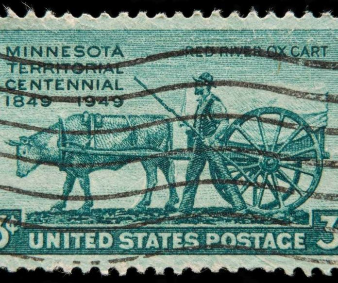 Who appeared on the first US commemorative postage stamp?